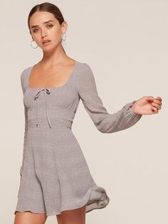 Talk romance to me. This is a mini length dress with a smocked waistband and a scoop neck.