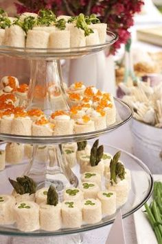 Rolled Tea Sandwiches: Curried Chicken Salad, Smoked Salmon with Dill Creme Fraiche, and, Caviar & Asparagus with Lemon Cream Cheese - Tea party catering by the Everyday Gourmet.