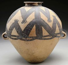 """STONEWARE STORAGE JAR. Neolithic Period (2nd century B.C.), China. Yang Shao culture. Various anthropomorphic and geometric designs in red and black/brown color. SIZE: 16"""" h x 17"""" dia."""