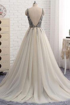 How about is the dress? 1.Silhouette:a-line 2.Fabric:tulle 3.Embellishment:rhinestone 4.Neckline:v neck 5.Sleeve:sleeveless 6.Waistline:Natural 7.Hem-length