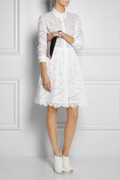 Christopher Kane skirt and top, Maison Martin Margiela cuff, Burberry Prorsum boots, Jil Sander clutch.