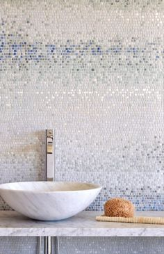 Mist, a hand chopped stone mosaic shown in tumbled Ming Green, Kays Green, Celeste, Calacatta, Blue Macauba and Lettuce Ming.