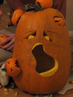 Creative pumpkin decorating using tiny pumpkins attached to a larger pumpkin.