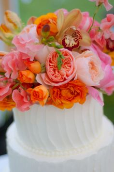 """pink & orange flowers on top of cake. in the words of RZ, """"bananas""""  Found the Cake"""