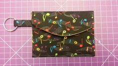 Pattern designed by AiviloCharlotte Designs. Pouch, Wallet, Coin Purses, Music Notes, Pattern Design, Coins, Shop, Handmade, Coin Wallet