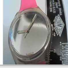 Swatch Watch. I had this style but black band. Loved the mirrored face and glow in the dark hands.