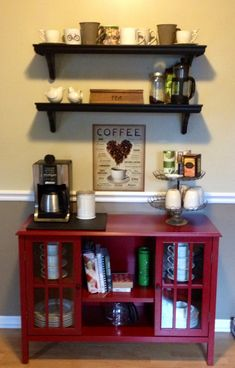 something similar to this basic idea - black cabinet for supplies (so probably not clear doors), sufficient usable surface space for coffee preparation etc., with upper shelf for microwave (if planning to upgrade that outlet).