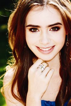 I see Sophie, as a young, pretty, and free spirited girl. I imagine her looking similar to Lilly Collins, who to me looks innocent and pure.