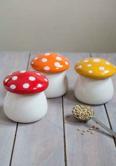 Amanita Second Helping Jar Set | A mushroom cap tops the opaque silhouette of these red, orange, and yellow canisters, which house your delightful confections in charming fashion.
