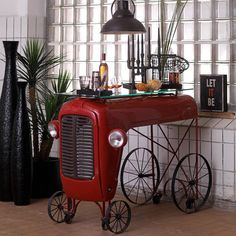 Tractor Bar - $3450 - Massey Ferguson Tractor Bar. Sew a stylish seed and add a quirky drop of agricultural furniture to your homestead with Smithers of Stamford's Vintage Style Tractor Bar. Our shiny red tractor front comes complete with metal spoke rolling caster wheels, headlamps, grill and glass worktop and makes an impressive breakfast bar in any kitchen serving up only the best in organic goods. Very cool bar design by Smithers of Stamford. Handmade from a recycled Vintage ...