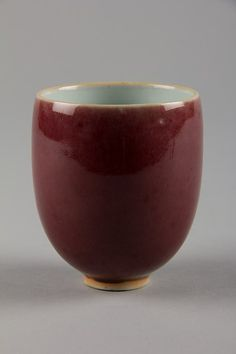 Qing dynasty (1644–1911) China. Porcelain cup with ox-blood glaze. H. 3 3/8 in; Diam. 2 3/4 in
