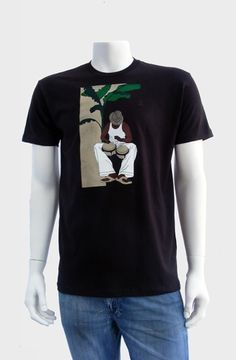 Bongocero (Dark Chocolate)  The Bongocero Tee depicts a solo percussionist banging away on his bongo drums seated under a banana tree. Screen printed with 6 colors onto 100% combed cotton jersey premium fitted crew with custom tag on hem. WRAP certified (worldwide responsible accredited production). ...