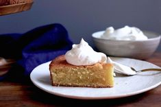 A moist, simple cake with two types of vanilla and a sweet, vanilla-flecked whipped cream topping.