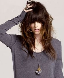 Wavy hair with bangs.
