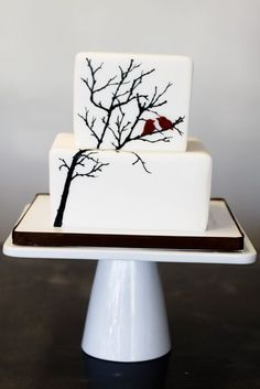 Kind of the basic concept that I'm gonna do with Kinsley's 1st birthday cake.  Except the tree will look like the one on her bedding.  Also, the cake will be round and will also have love birds on it. : )  So excited!
