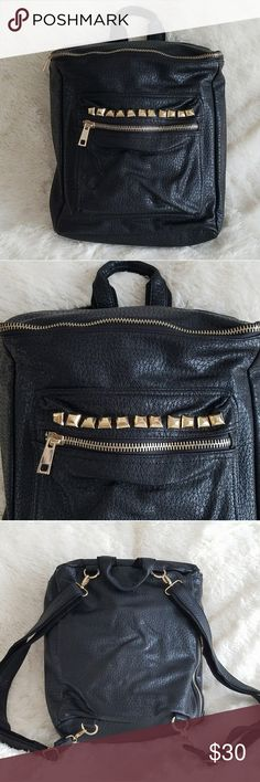 Gold Studded Black Backpack Black backpack with gold studs and zipper details. Straps are adjustable. Only used once for a trip. Clean and in excellent condition.   Sorry no trades, hold over 24 hours, or payments requests outside Poshmark. Reasonable offers welcome! 😊 Bags Backpacks