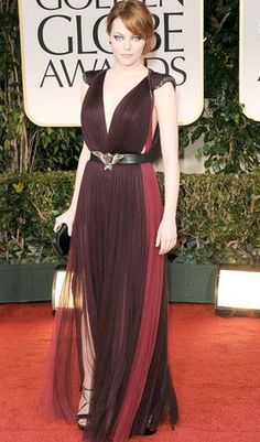 Emma Stone is seriously hot.  Rocking her sexy, smokey eye with this deep plum dress