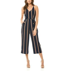 Embrace modern style while flattering your curves with this figure-defining all-in-one jumpsuit, cropped just below the knee to show off your favorite kicks. Size note: This item runs in European sizing. Please refer to the size chart.