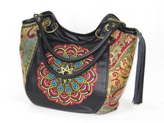 genuine leather and paisley tapestry bucket style handbag