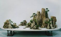 Image from http://www.absolutechinatours.com/UploadFiles/ImageBase/Penzai-Chinese-potted-landscape-Chinese-Bonsai-9(1).jpg.