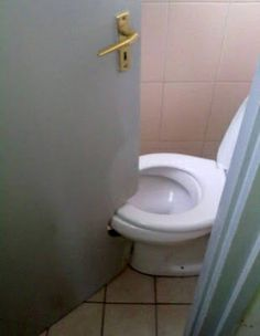 This Is Very Humor Picture Of A Toilet Door. In This Funny Picture The Door Of A Toilet Was Designed According To The Wrong Construction Of Bathroom. All This Happened Because Of Very Short Area Inside The Bathroom.