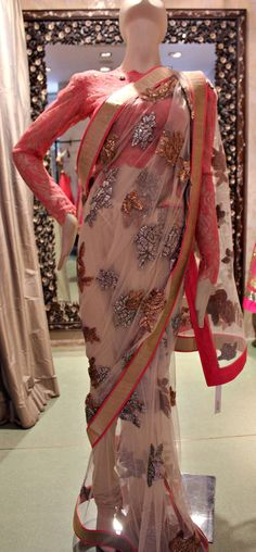 An understated yet elegant sari with gold and silver work that will take your breath away.