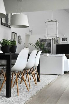 Scandinavian minimalist living room with Eames chairs and plants