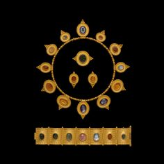Archaeological Style Parure. Maker:Carlo Giuliano. Material:Gold, Amethyst, Chalcedony, Cornelian, Jasper, Nicolo, Plasma, Sard