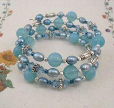Memory Wire Bracelet - Bold Blue Opalite Swarovski Crystal and Freshwater Pearl. $20.00, via Etsy.