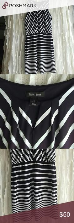 "WHITE HOUSE BLACK MARKET B&W DRESS Black and white stripes that will flatter you. It's comfortable slip on dress. Has a little keyhole front classy flirty;) comes down below my knees I'm 5.3"". White House Black Market Dresses Midi"