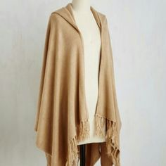 """Cozy Oversized Modcloth Tan Shawl This is amazing and soft, New with tags the length measures 38"""" it is a 100% Acrylic. Has a hood and beautiful fringed hemline. Great for a outdoor football game or pair it with skinny jeans. It will keep you warm and cozy.Can fit a Medium/ Large PRICE IS FIRM! ModCloth Sweaters"""