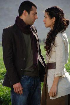 Murat Yildirim as Demir and Tuba Buyukustun as Asi in the Turkish TV series ASI.