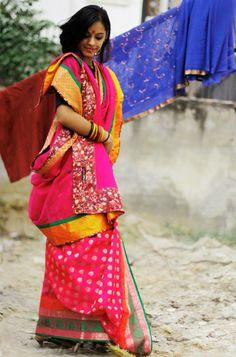 CR1311234 - Fushia pink saree with pleats in banaras, chanderi & palla in pure georgette. Border is in pure brocade and pure silk turmic yellow color with green patti. Facing in ditsy floral fushia color.