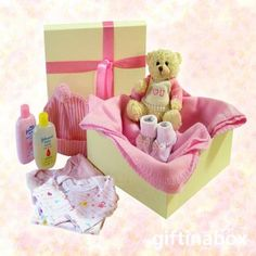 Welcome to the new baby girl of the family. Give her lots of love with these beautiful products and her own snuggly pink cuddle blanket. All goods are lovingly presented in a cream gift hamper box decorated with pink ribbons and tissue paper.   Cuddly teddy bear Sock booties 2 cotton vests Baby leggings Baby beanie Baby lotion Baby powder Baby soap Pink snuggle blanket Ferrero Rocher chocolate trio for mom