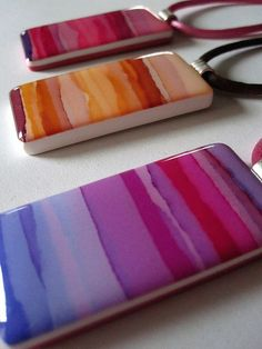 Photo transfer on polymer clay, topped with resin. -watercolor horizons 2, via Flickr.