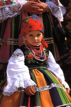 A little girl wearing traditional costume from Łowicz, Poland