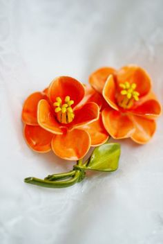 Vintage peach enamel flowers brooch with yellow centers and green stem by PuddinRidgeCreations for $14.99
