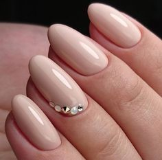 Simple pastel pink nail art with jewels