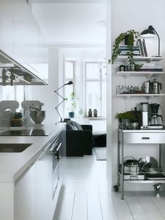 White kitchen + stainless steel. Appliances out in the open but still looking clean and uncluttered