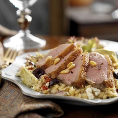 Duck Couscous with Maple Leaf Farms Boneless Duck Breast Filets - To serve: slice the duck breast across the grain into medallions. On each of the four dinner plates place a helping of couscous topped with 4- 5 pieces of duck breast. Sprinkle with pine nuts and fresh ground pepper.