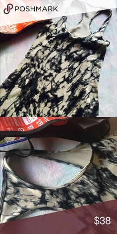 Lululemon yoga top Love this tie dye pattern . Beige black grey. Racer  back .  Doesn't have a built in bra. Comes with lulu bag. Great condition . Will fit a 4-8 . As is no trades or PP. lululemon athletica Tops