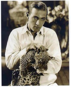 Two Beauties - Rudy Valentino and leopard cub.