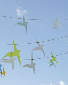 String a garland of cut-out vellum birds across your venue for big-impact decor.