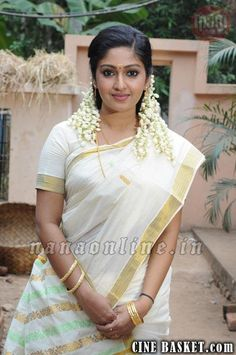 Mithra is a Kerala saree: isn't there something wonderfully charming about a girl who wears flowers in her hair?