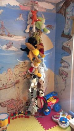 Stuffed animal storage idea. Rope and cloths pins from Dollar Tree. Cheap and easy. Cost $2.14 Time 15mins.