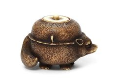 AN IVORY NETSUKE OF THE BUNBUKU CHAGAMA (BADGER TEA KETTLE) By Ohara Mitsuhiro (1810-1875), Osaka, 19th century Sold for US$ 19,322 inc. premium THE HARRIET SZECHENYI SALE OF JAPANESE ART 8 Nov 2011. Bonhams