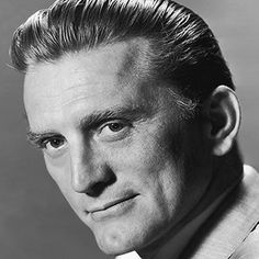 QUICK FACTS    NAME: Issur Danielovitch  OCCUPATION: Film Actor, Theater Actor, Television Actor, Director, Producer  BIRTH DATE: December 09, 1916 (Age: 95)  PLACE OF BIRTH: Amsterdam, New York  AKA: Kirk Douglas  ZODIAC SIGN: Sagittarius  BEST KNOWN FOR    Actor Kirk Douglas brought his formidable chin and talent to movies like Spartacus and The Bad and the Beautiful. You may also know him as the father of Michael Douglas.