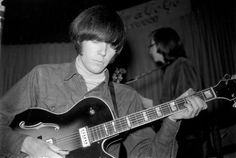 Neil Young, with Buffalo Springfield, auditioning for the Whisky A Go Go, using a borrowed guitar from The Dillards, in May 1966