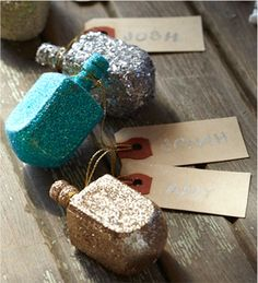 Glittery Dreidel Place Cards or table decorations - These would look great with our Hanukkah Table Scatter Hanukkah Crafts, Hanukkah Decorations, Hannukah, Holiday Crafts, Table Decorations, Menorah, Winter Holidays, Happy Holidays, How To Celebrate Hanukkah