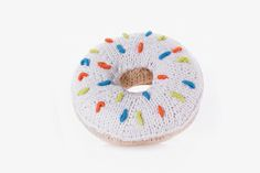 Who can resist a rattle in the shape of a donut? The proceeds of this delicious knit toy (available in pink and white) help women rise out of poverty in rural Bangladesh.